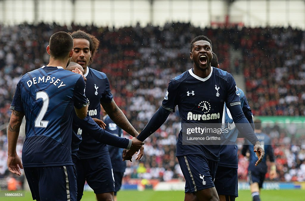 <a gi-track='captionPersonalityLinkClicked' href=/galleries/search?phrase=Emmanuel+Adebayor&family=editorial&specificpeople=484018 ng-click='$event.stopPropagation()'>Emmanuel Adebayor</a> (R) celebtrates after scoring his team's second goal during the Barclays Premier League match between Stoke City and Tottenham Hotspur at Britannia Stadium on May 12, 2013 in Stoke on Trent, England.