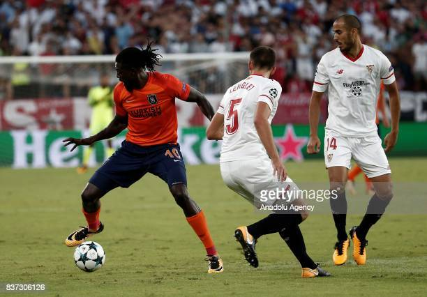 Emmanuel Adebayor in action against Clement Lenglet and Guido Pizarro of Sevilla during the UEFA Champions League playoff match between Sevilla and...