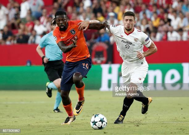 Emmanuel Adebayor in action against Clement Lenglet of Sevilla during the UEFA Champions League playoff match between Sevilla and Medipol Basaksehir...