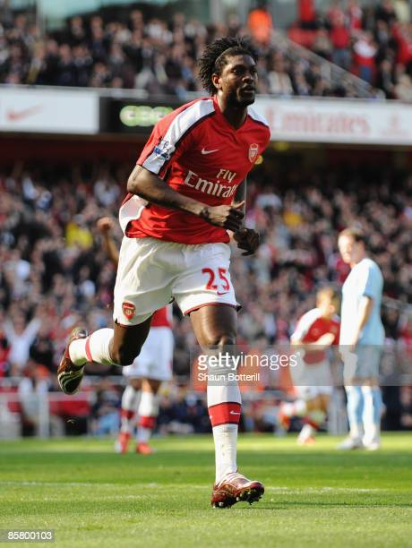 Emmanuel Adebayor of Arsenal celebrates scoring his team's first goal during the Barclays Premier League match between Arsenal and Manchester City at...