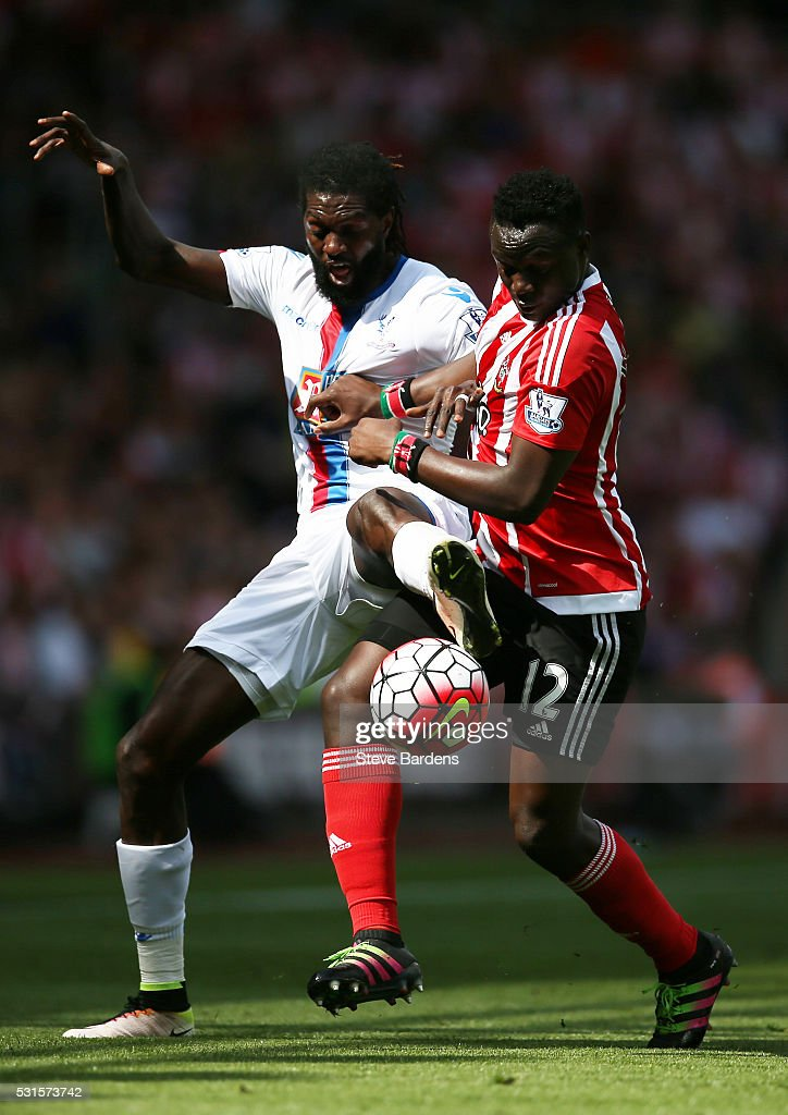 Emmanuel Adebayor of Crystal Palace and Victor Wanyama of Soauthampton compete for the ball during the Barclays Premier League match between Southampton and Crystal Palace at St Mary's Stadium on May 15, 2016 in Southampton, England.