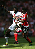 Emmanuel Adebayor of Crystal Palace and Victor Wanyama of Soauthampton compete for the ball during the Barclays Premier League match between...