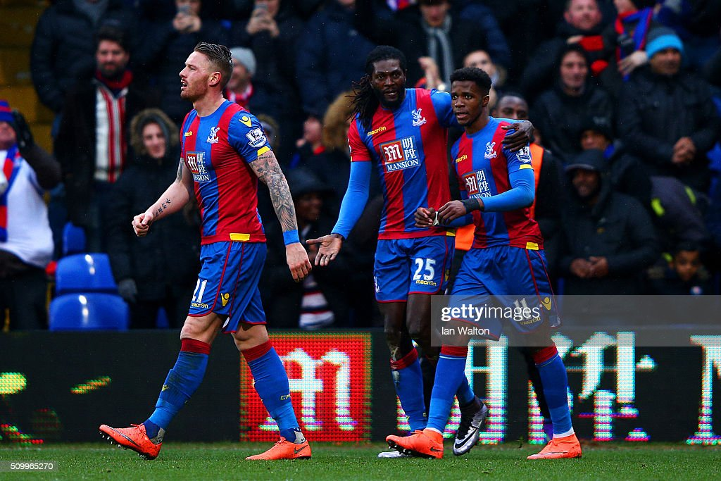 <a gi-track='captionPersonalityLinkClicked' href=/galleries/search?phrase=Emmanuel+Adebayor&family=editorial&specificpeople=484018 ng-click='$event.stopPropagation()'>Emmanuel Adebayor</a> (C) of Crystal Palace celebrates scoring his team's first goal with his team mates <a gi-track='captionPersonalityLinkClicked' href=/galleries/search?phrase=Wilfried+Zaha&family=editorial&specificpeople=7132531 ng-click='$event.stopPropagation()'>Wilfried Zaha</a> (R) and <a gi-track='captionPersonalityLinkClicked' href=/galleries/search?phrase=Connor+Wickham&family=editorial&specificpeople=6148574 ng-click='$event.stopPropagation()'>Connor Wickham</a> (L) during the Barclays Premier League match between Crystal Palace and Watford at Selhurst Park on February 13, 2016 in London, England.
