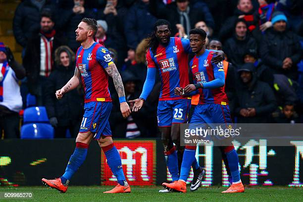 Emmanuel Adebayor of Crystal Palace celebrates scoring his team's first goal with his team mates Wilfried Zaha and Connor Wickham during the Barclays...