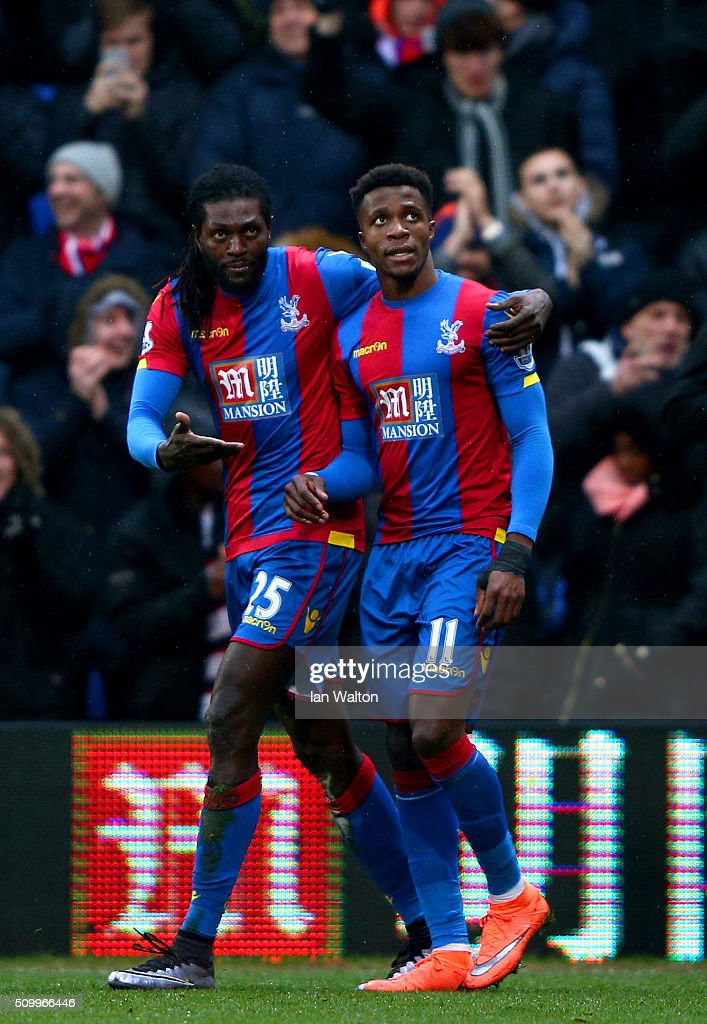 Emmanuel Adebayor (L) of Crystal Palace celebrates scoring his team's first goal with his team mates Wilfried Zaha (R) during the Barclays Premier League match between Crystal Palace and Watford at Selhurst Park on February 13, 2016 in London, England.