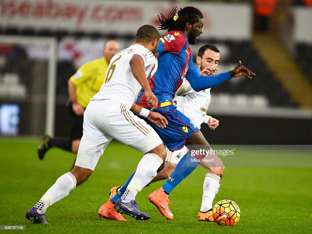 <a gi-track='captionPersonalityLinkClicked' href=/galleries/search?phrase=Emmanuel+Adebayor&family=editorial&specificpeople=484018 ng-click='$event.stopPropagation()'>Emmanuel Adebayor</a> (C) of Crystal Palace competes for the ball against <a gi-track='captionPersonalityLinkClicked' href=/galleries/search?phrase=Ashley+Williams+-+Soccer+Player&family=editorial&specificpeople=13495389 ng-click='$event.stopPropagation()'>Ashley Williams</a> (L) and <a gi-track='captionPersonalityLinkClicked' href=/galleries/search?phrase=Leon+Britton+-+Soccer+Player&family=editorial&specificpeople=12884689 ng-click='$event.stopPropagation()'>Leon Britton</a> (R) of Swansea City during the Barclays Premier League match between Swansea City and Crystal Palace at the Liberty Stadium on February 6, 2016 in Swansea, Wales.