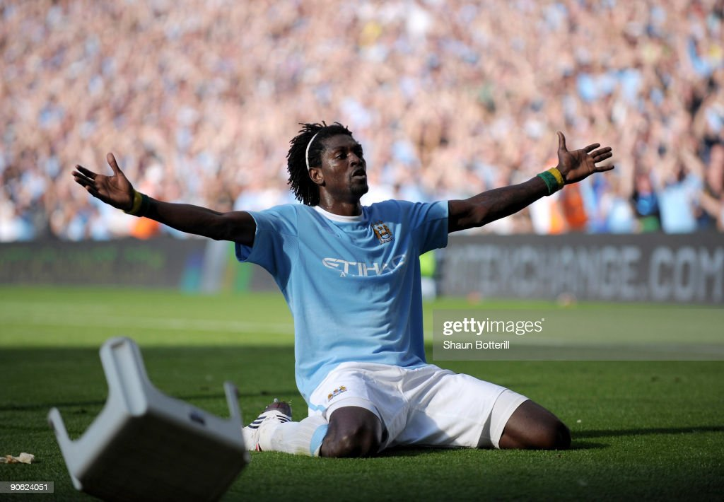 <a gi-track='captionPersonalityLinkClicked' href=/galleries/search?phrase=Emmanuel+Adebayor&family=editorial&specificpeople=484018 ng-click='$event.stopPropagation()'>Emmanuel Adebayor</a> of Manchester City celebrates in front of the Arsenal fans after scoring during the Barclays Premier League match between Manchester City and Arsenal at the City of Manchester Stadium on September 12, 2009 in Manchester, England.