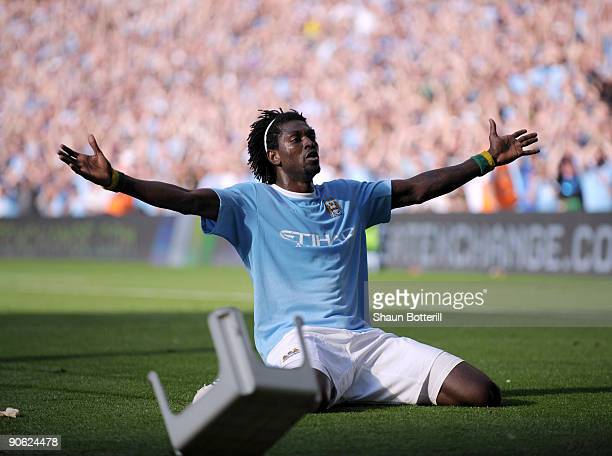 Emmanuel Adebayor of Manchester City celebrates in front of the Arsenal fans after scoring during the Barclays Premier League match between...