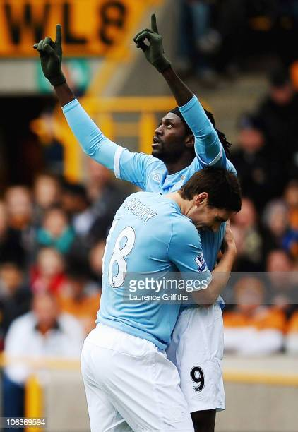 Emmanuel Adebayor of Manchester City is congratulated on his spot kick by Gareth Barry during the Barclays Premier League match between Wolverhampton...