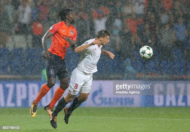 Emmanuel Adebayor of Medipol Basaksehir in action against Clement Lenglet of Sevilla FC during the UEFA Champions League playoff match between...