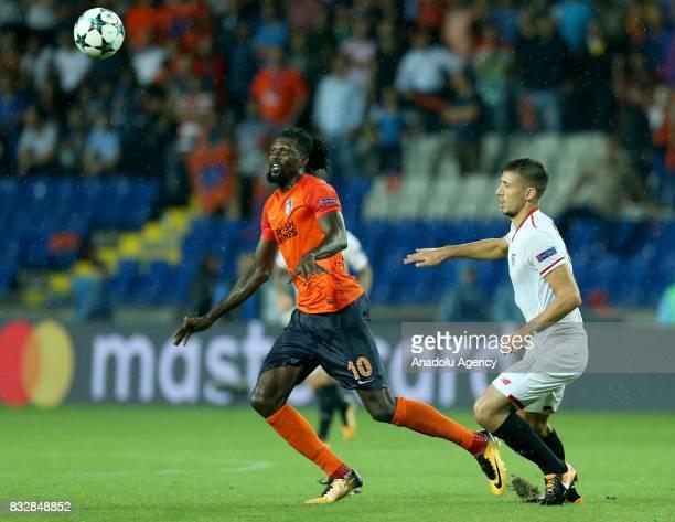 Emmanuel Adebayor of Medipol Basaksehir in action against Gabriel Mercado of Sevilla FC during the UEFA Champions League playoff match between...