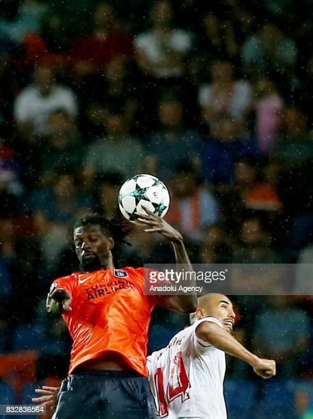 Emmanuel Adebayor of Medipol Basaksehir in action against Guido Pizarro of Sevilla FC during the UEFA Champions League playoff match between Medipol...