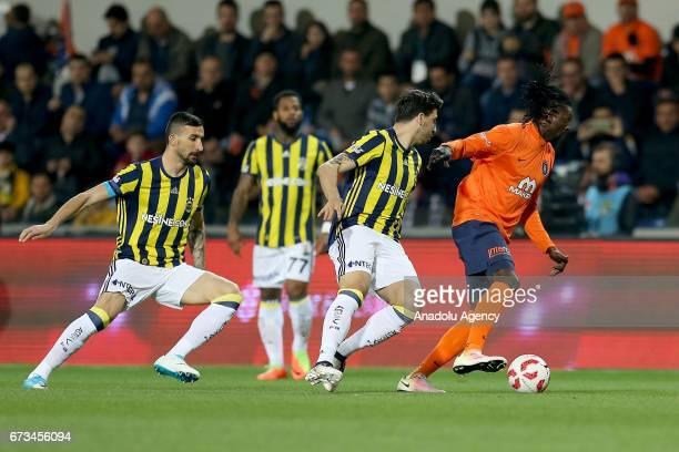 Emmanuel Adebayor of Medipol Basaksehir in action against Ozan Tufan and Mehmet Topal of Fenerbahce during the Ziraat Turkish Cup semi final soccer...