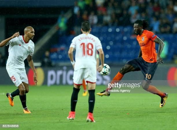 Emmanuel Adebayor of Medipol Basaksehir in action against Sergio Escudero of Sevilla FC during the UEFA Champions League playoff match between...