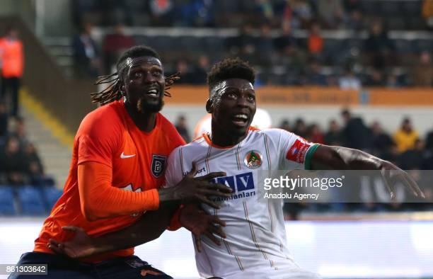Emmanuel Adebayor of Medipol Basaksehir vies with Lamine Gassama of Aytemiz Alanyaspor during the Turkish Super Lig soccer match between Medipol...