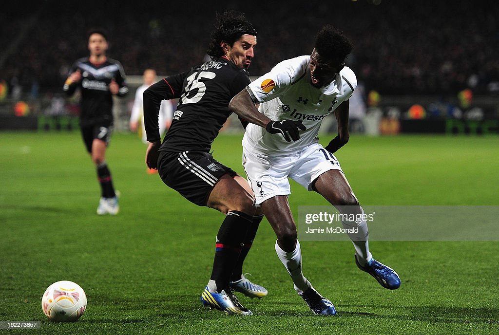 <a gi-track='captionPersonalityLinkClicked' href=/galleries/search?phrase=Emmanuel+Adebayor&family=editorial&specificpeople=484018 ng-click='$event.stopPropagation()'>Emmanuel Adebayor</a> of Spurs battles with <a gi-track='captionPersonalityLinkClicked' href=/galleries/search?phrase=Milan+Bisevac&family=editorial&specificpeople=600075 ng-click='$event.stopPropagation()'>Milan Bisevac</a> of Olympique Lyonnais during the UEFA Europa League Round of 32, second leg match between Olympique Lyonnais and Tottenham Hotspur FC at Stade de Gerland on February 21, 2013 in Lyon, France.