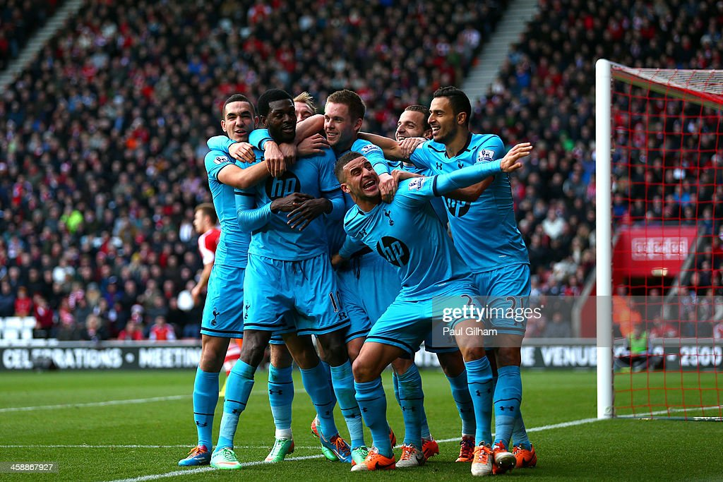<a gi-track='captionPersonalityLinkClicked' href=/galleries/search?phrase=Emmanuel+Adebayor&family=editorial&specificpeople=484018 ng-click='$event.stopPropagation()'>Emmanuel Adebayor</a> (2nd L) of Spurs celebrates with teammates after scoring his team's third goal during the Barclays Premier League match between Southampton and Tottenham Hotspur at St Mary's Stadium on December 22, 2013 in Southampton, England.