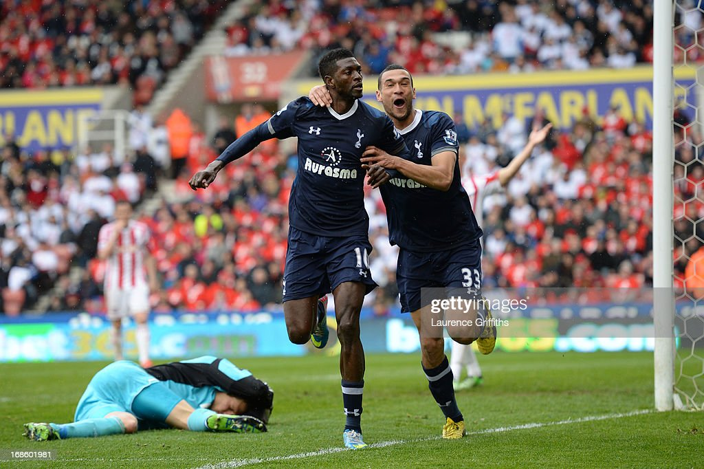 <a gi-track='captionPersonalityLinkClicked' href=/galleries/search?phrase=Emmanuel+Adebayor&family=editorial&specificpeople=484018 ng-click='$event.stopPropagation()'>Emmanuel Adebayor</a> of Spurs is congratulated by teammate <a gi-track='captionPersonalityLinkClicked' href=/galleries/search?phrase=Steven+Caulker+-+Soccer+Player&family=editorial&specificpeople=6527106 ng-click='$event.stopPropagation()'>Steven Caulker</a> (R) after scoring his team's second goal during the Barclays Premier League match between Stoke City and Tottenham Hotspur at Britannia Stadium on May 12, 2013 in Stoke on Trent, England.