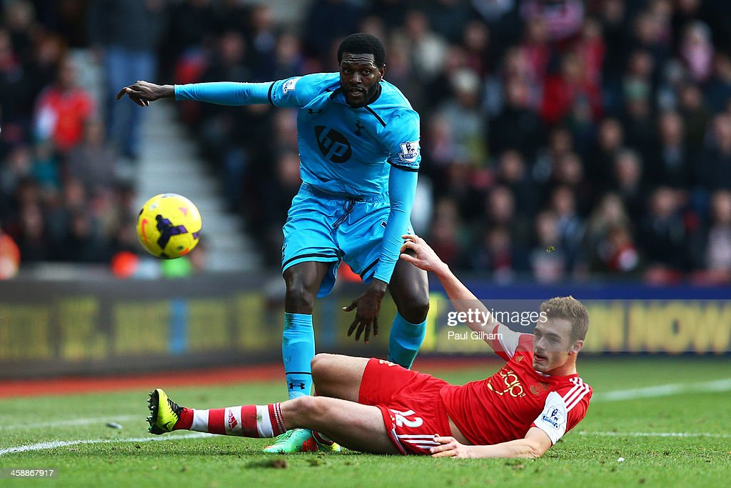 <a gi-track='captionPersonalityLinkClicked' href=/galleries/search?phrase=Emmanuel+Adebayor&family=editorial&specificpeople=484018 ng-click='$event.stopPropagation()'>Emmanuel Adebayor</a> of Spurs is tackled by <a gi-track='captionPersonalityLinkClicked' href=/galleries/search?phrase=Calum+Chambers+-+Soccer+Player&family=editorial&specificpeople=10599271 ng-click='$event.stopPropagation()'>Calum Chambers</a> of Southampton during the Barclays Premier League match between Southampton and Tottenham Hotspur at St Mary's Stadium on December 22, 2013 in Southampton, England.