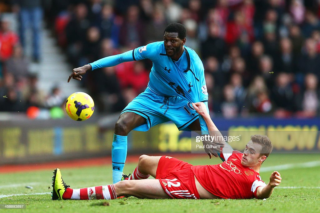 <a gi-track='captionPersonalityLinkClicked' href=/galleries/search?phrase=Emmanuel+Adebayor&family=editorial&specificpeople=484018 ng-click='$event.stopPropagation()'>Emmanuel Adebayor</a> of Spurs is tackled by <a gi-track='captionPersonalityLinkClicked' href=/galleries/search?phrase=Morgan+Schneiderlin&family=editorial&specificpeople=4191360 ng-click='$event.stopPropagation()'>Morgan Schneiderlin</a> of Southampton during the Barclays Premier League match between Southampton and Tottenham Hotspur at St Mary's Stadium on December 22, 2013 in Southampton, England.