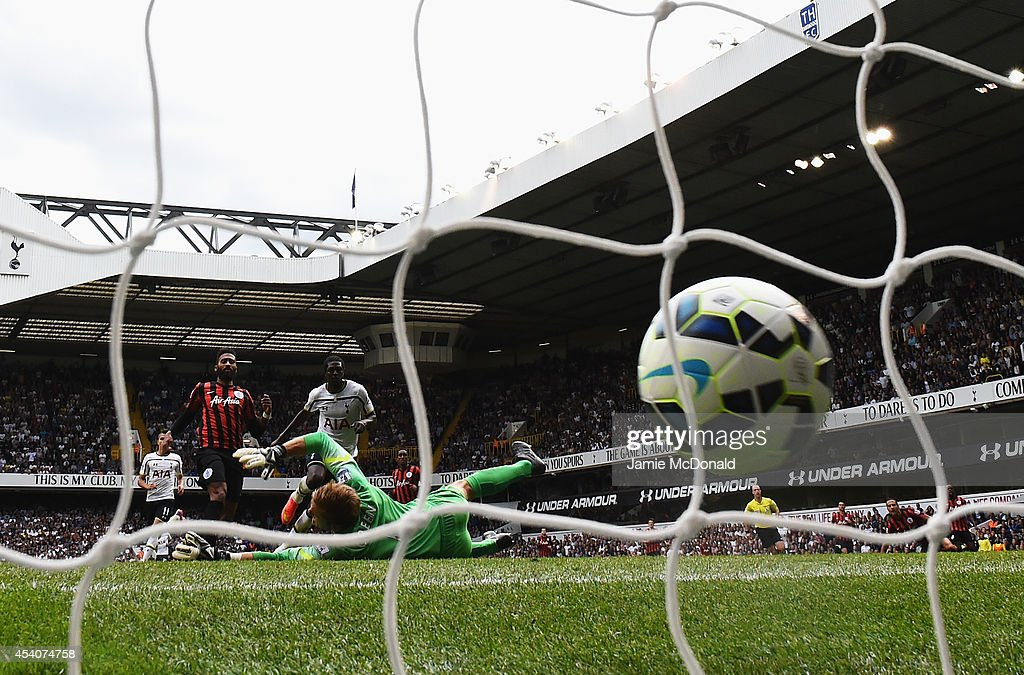<a gi-track='captionPersonalityLinkClicked' href=/galleries/search?phrase=Emmanuel+Adebayor&family=editorial&specificpeople=484018 ng-click='$event.stopPropagation()'>Emmanuel Adebayor</a> of Spurs scores his goal during the Barclays Premier League match between Tottenham Hotspur and Queens Park Rangers at White Hart Lane on August 24, 2014 in London, England.