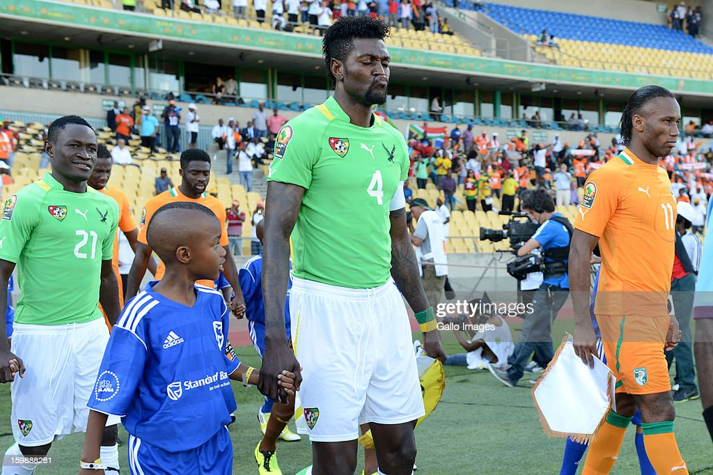 <a gi-track='captionPersonalityLinkClicked' href=/galleries/search?phrase=Emmanuel+Adebayor&family=editorial&specificpeople=484018 ng-click='$event.stopPropagation()'>Emmanuel Adebayor</a> of Togo (C) and <a gi-track='captionPersonalityLinkClicked' href=/galleries/search?phrase=Didier+Drogba&family=editorial&specificpeople=179398 ng-click='$event.stopPropagation()'>Didier Drogba</a> of Ivory Coast during the 2013 Orange African Cup of Nations match between Ivory Coast and Togo at Royal Bafokeng Stadium on January 22, 2013 in Rustenburg, South Africa.