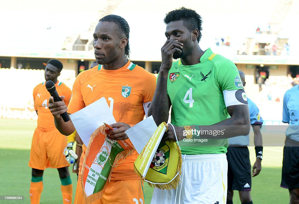 <a gi-track='captionPersonalityLinkClicked' href=/galleries/search?phrase=Emmanuel+Adebayor&family=editorial&specificpeople=484018 ng-click='$event.stopPropagation()'>Emmanuel Adebayor</a> of Togo (R) and <a gi-track='captionPersonalityLinkClicked' href=/galleries/search?phrase=Didier+Drogba&family=editorial&specificpeople=179398 ng-click='$event.stopPropagation()'>Didier Drogba</a> of Ivory Coast during the 2013 Orange African Cup of Nations match between Ivory Coast and Togo at Royal Bafokeng Stadium on January 22, 2013 in Rustenburg, South Africa.