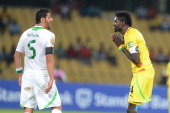 Emmanuel Adebayor of Togo and Rafik Halliche of Algeria during the 2013 African Cup of Nations match between Togo and Algeria at Royal Bafokeng...