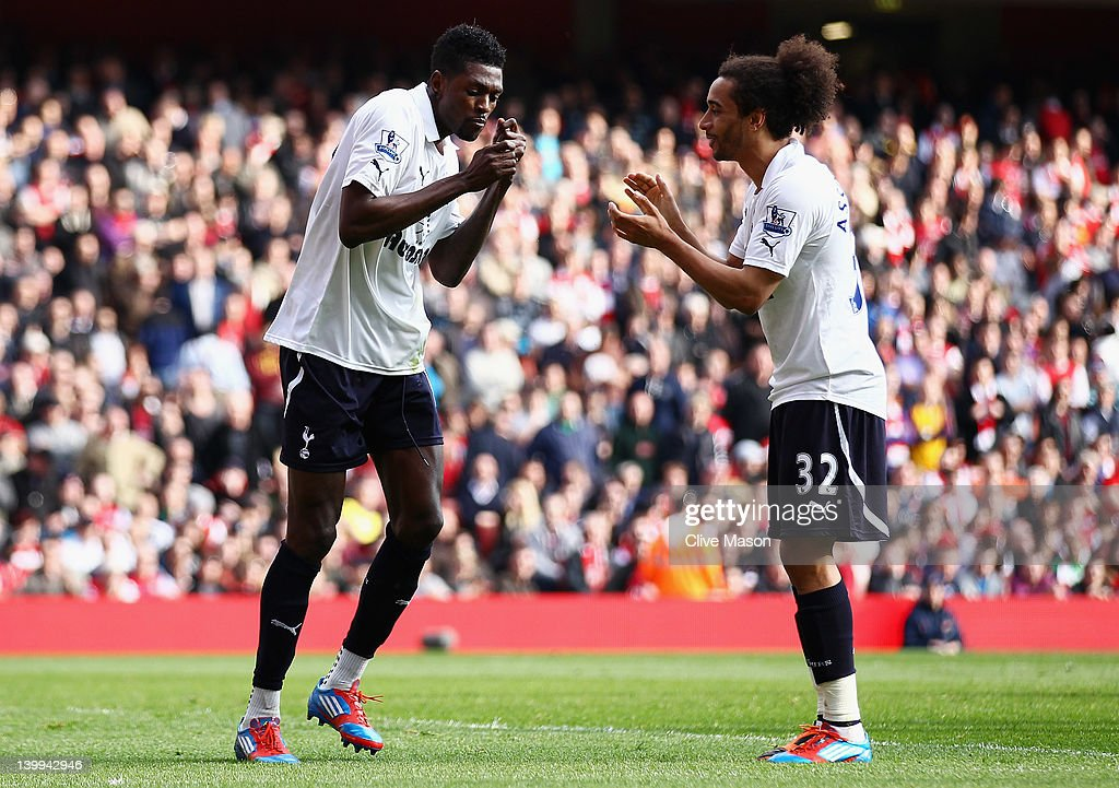 <a gi-track='captionPersonalityLinkClicked' href=/galleries/search?phrase=Emmanuel+Adebayor&family=editorial&specificpeople=484018 ng-click='$event.stopPropagation()'>Emmanuel Adebayor</a> (L) of Tottenham Hotspur celebrates his penalty with <a gi-track='captionPersonalityLinkClicked' href=/galleries/search?phrase=Benoit+Assou-Ekotto&family=editorial&specificpeople=709848 ng-click='$event.stopPropagation()'>Benoit Assou-Ekotto</a> during the Barclays Premier League match between Arsenal and Tottenham Hotspur at Emirates Stadium on February 26, 2012 in London, England.