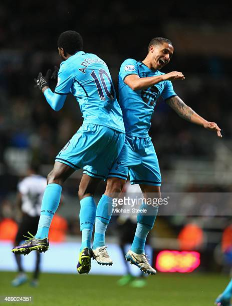 Emmanuel Adebayor of Tottenham Hotspur celebrates scoring his sides third goal with Kyle Naughton during the Barclays Premier League match between...