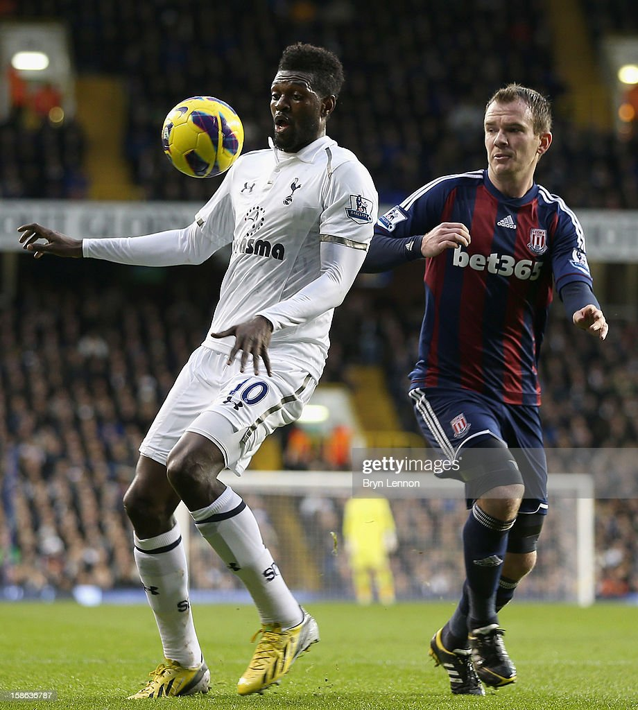 Emmanuel Adebayor of Tottenham Hotspur controls the ball under pressure from Glenn Whelan of Stoke City during the Barclays Premier League match between Tottenham Hotspur and Stoke City at White Hart Lane on December 22, 2012 in London, England.