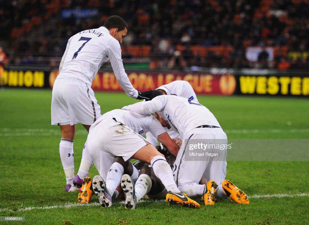 <a gi-track='captionPersonalityLinkClicked' href=/galleries/search?phrase=Emmanuel+Adebayor&family=editorial&specificpeople=484018 ng-click='$event.stopPropagation()'>Emmanuel Adebayor</a> of Tottenham Hotspur is congratulated by team mates as he scores their first goal during UEFA Europa League Round of 16 second leg match between Inter Milan and Tottenham Hotspur at San Siro Stadium on March 14, 2013 in Milan, Italy.
