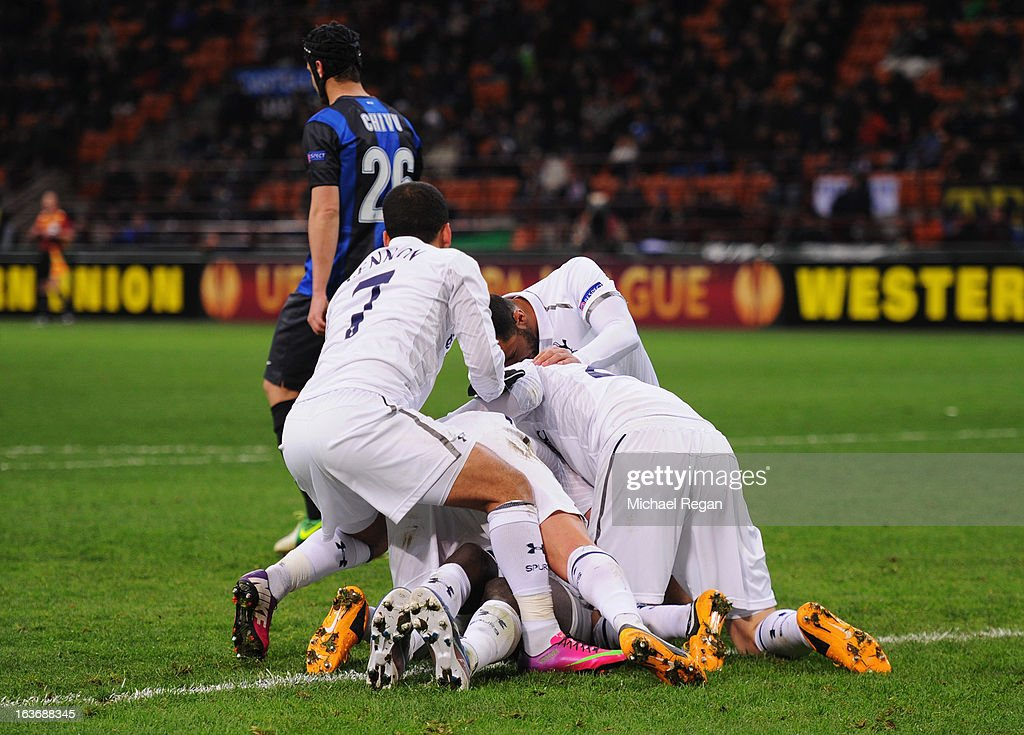 Emmanuel Adebayor of Tottenham Hotspur (obscured) is congratulated by team mates as he scores their first goal during UEFA Europa League Round of 16 second leg match between Inter Milan and Tottenham Hotspur at San Siro Stadium on March 14, 2013 in Milan, Italy.