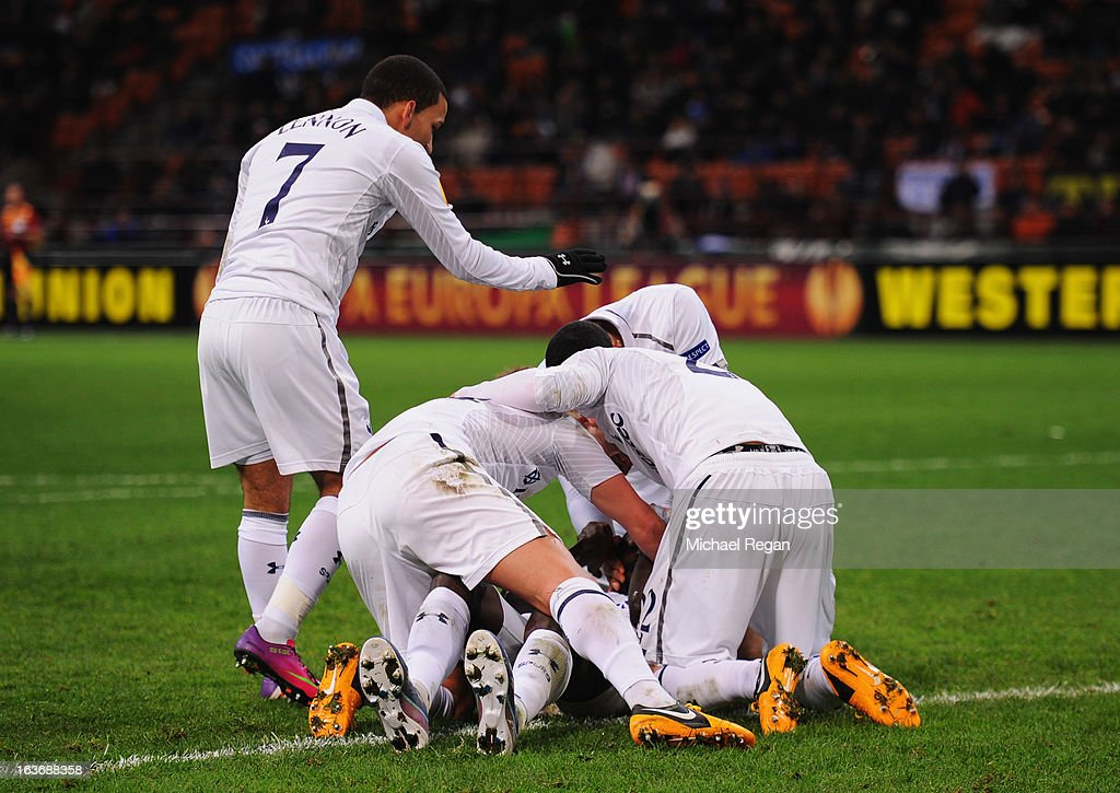 Emmanuel Adebayor of Tottenham Hotspur is congratulated by team mates as he scores their first goal during UEFA Europa League Round of 16 second leg match between Inter Milan and Tottenham Hotspur at San Siro Stadium on March 14, 2013 in Milan, Italy.