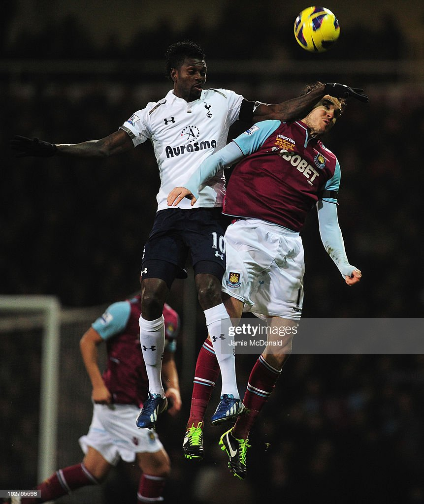Emmanuel Adebayor of Tottenham Hotspur jumps for a header with Joey O'Brien of West Ham United during the Barclays Premier League match between West Ham United and Tottenham Hotspur at the Boleyn Ground on February 25, 2013 in London, England.