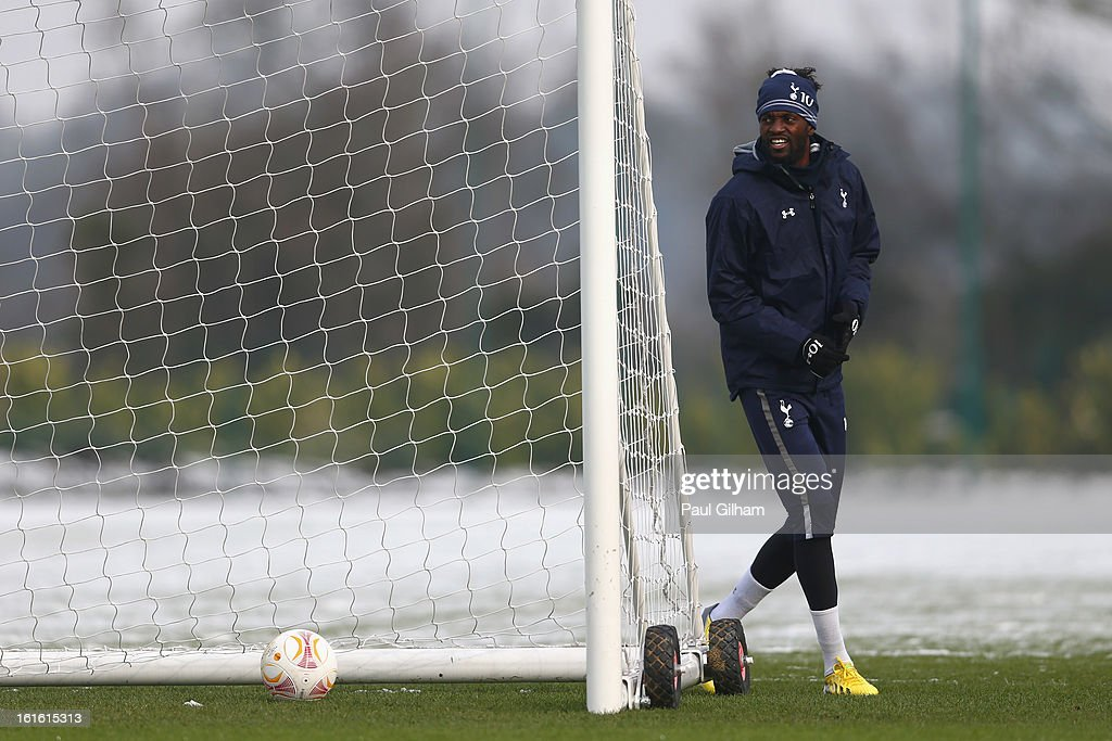 <a gi-track='captionPersonalityLinkClicked' href=/galleries/search?phrase=Emmanuel+Adebayor&family=editorial&specificpeople=484018 ng-click='$event.stopPropagation()'>Emmanuel Adebayor</a> of Tottenham Hotspur looks on during a Tottenham Hotspur training session ahead of thier UEFA Cup round of 32 match against Lyon on February 13, 2013 in Enfield, England.