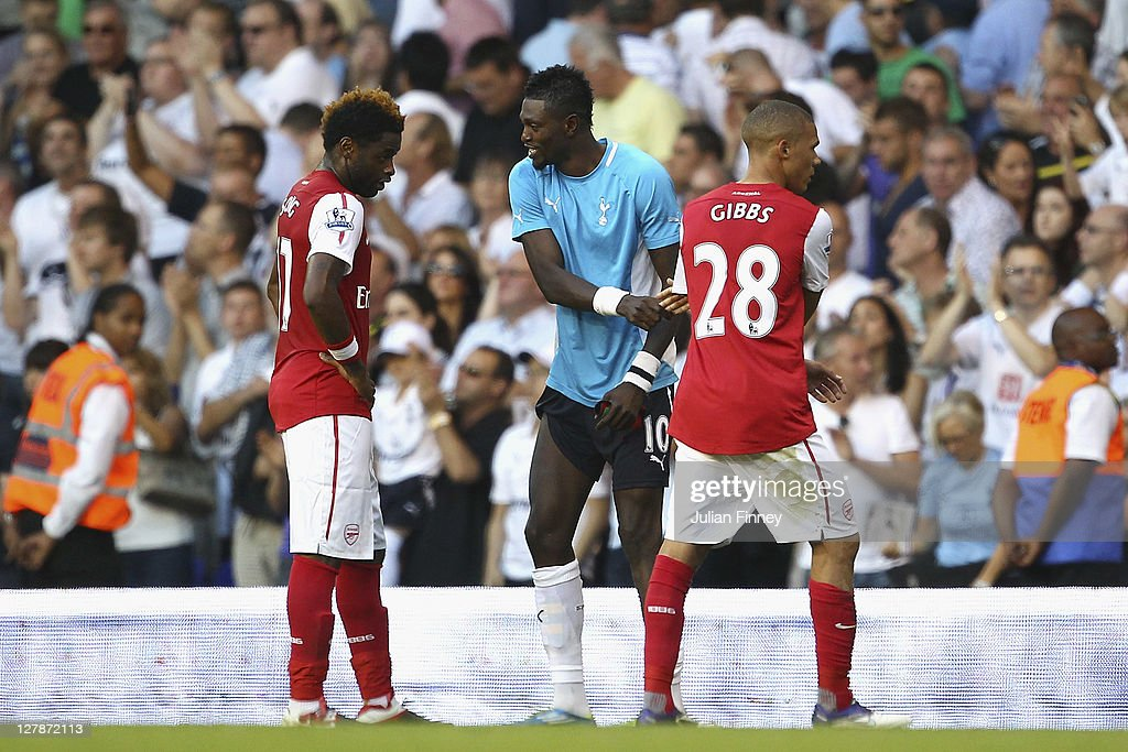 <a gi-track='captionPersonalityLinkClicked' href=/galleries/search?phrase=Emmanuel+Adebayor&family=editorial&specificpeople=484018 ng-click='$event.stopPropagation()'>Emmanuel Adebayor</a> of Tottenham Hotspur (C) shakes the hands of his former team mates <a gi-track='captionPersonalityLinkClicked' href=/galleries/search?phrase=Alex+Song&family=editorial&specificpeople=652067 ng-click='$event.stopPropagation()'>Alex Song</a> (L) and <a gi-track='captionPersonalityLinkClicked' href=/galleries/search?phrase=Kieran+Gibbs&family=editorial&specificpeople=4192585 ng-click='$event.stopPropagation()'>Kieran Gibbs</a> of Arsenal during the Barclays Premier League match between Tottenham Hotspur and Arsenal at White Hart Lane on October 2, 2011 in London, England.