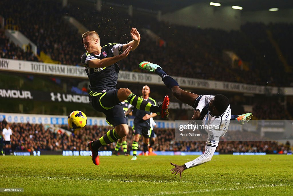Emmanuel Adebayor of Tottenham Hotspur volleys the ball hitting the hand of Ryan Shawcross of Stoke City, leading to a penalty during the Barclays Premier League match between Tottenham Hotspur and Stoke City at White Hart Lane on December 29, 2013 in London, England.