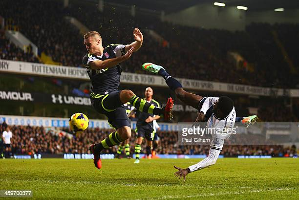 Emmanuel Adebayor of Tottenham Hotspur volleys the ball hitting the hand of Ryan Shawcross of Stoke City leading to a penalty during the Barclays...