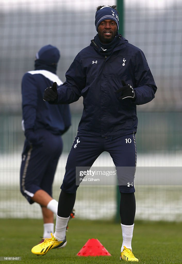 <a gi-track='captionPersonalityLinkClicked' href=/galleries/search?phrase=Emmanuel+Adebayor&family=editorial&specificpeople=484018 ng-click='$event.stopPropagation()'>Emmanuel Adebayor</a> of Tottenham Hotspur warms up during a Tottenham Hotspur training session ahead of thier UEFA Cup round of 32 match against Lyon on February 13, 2013 in Enfield, England.