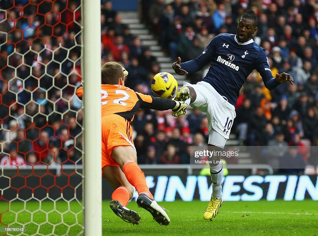 <a gi-track='captionPersonalityLinkClicked' href=/galleries/search?phrase=Emmanuel+Adebayor&family=editorial&specificpeople=484018 ng-click='$event.stopPropagation()'>Emmanuel Adebayor</a> of Tottenham shots is saved by Simon Mignolet of Suinderland during the Barclays Premier League match between Sunderland and Tottenham Hotspur at Stadium of Light on December 29, 2012 in Sunderland, England.