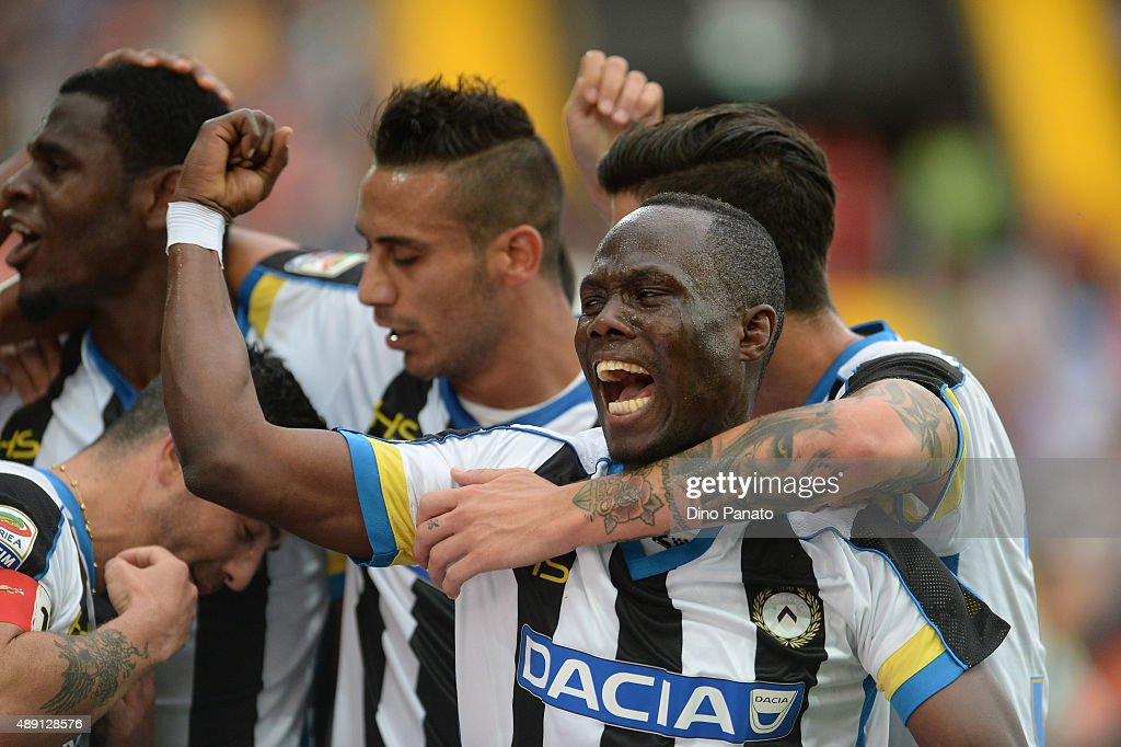 Emmanuel Agyemang Badu of Udinese Calcio celebrate with team mates after zapata's goal during the Serie A match between Udinese Calcio v Empoli FC at Stadio Friuli on September 19, 2015 in Udine, Italy.