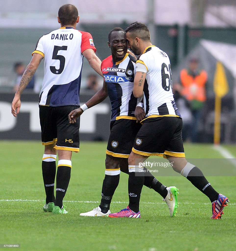 Emmanuel Agyemang Badu (L) of Udinese Calcio celebrates with his teams mate <a gi-track='captionPersonalityLinkClicked' href=/galleries/search?phrase=Giampiero+Pinzi&family=editorial&specificpeople=2164981 ng-click='$event.stopPropagation()'>Giampiero Pinzi</a> after scoring his teams second goal during the Serie A match between Udinese Calcio and AC Milan at Stadio Friuli on April 25, 2015 in Udine, Italy.