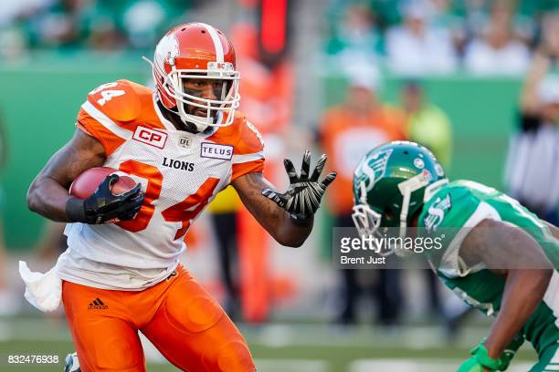 Emmanuel Arceneaux of the BC Lions looks to avoid a Roughrider defender in the game between the BC Lions and the Saskatchewan Roughriders at Mosaic...