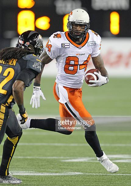 Emmanuel Arceneaux of the BC Lions runs the ball against the Hamilton Tigercats in a CFL football game at Tim Hortons Field on October 4 2014 in...