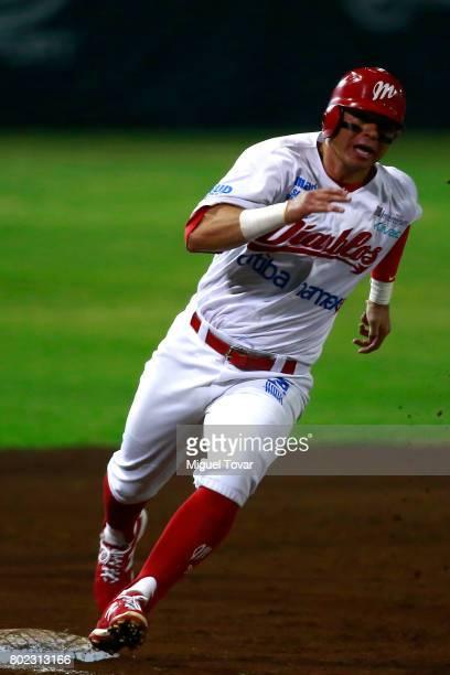 Emmanuel Avila of Diablos runs the third base during the match between Rojos del Aguila and Diablos Rojos as part of the Liga Mexicana de Beisbol...