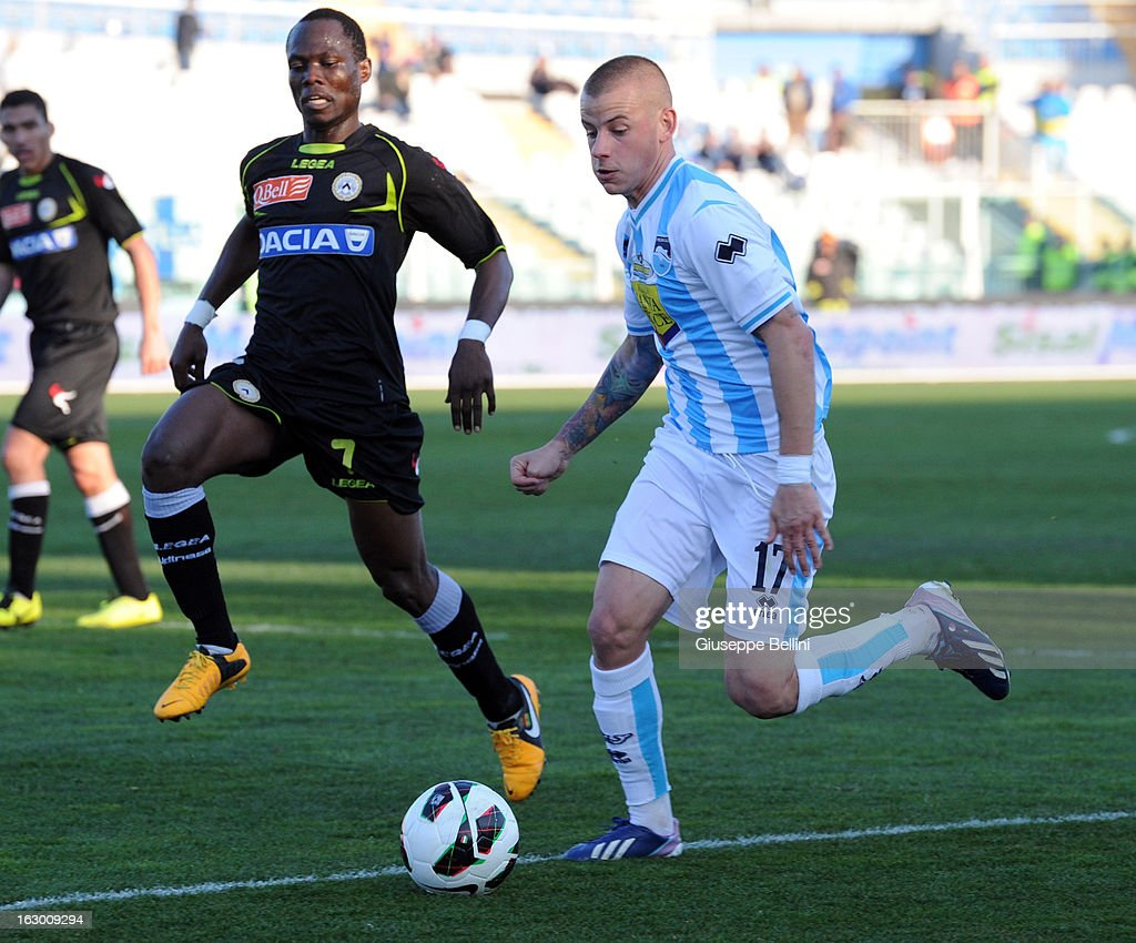 Emmanuel Badu of Udinese and Vladimir Weiss of Pescara in action during the Serie A match between Pescara and Udinese Calcio at Adriatico Stadium on March 3, 2013 in Pescara, Italy.
