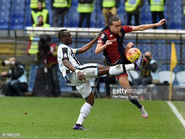 Emmanuel Badu of Udinese calcio competes for the ball with Diego Laxalt of Genoa CFC during the Serie A match between Genoa CFC and Udinese Calcio at...
