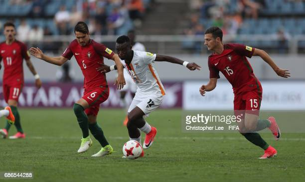 Emmanuel Banda of Zambia battles with Pepe of Portugal and Diogo Dalot of Portugal during the FIFA U20 World Cup Korea Republic 2017 group C match...