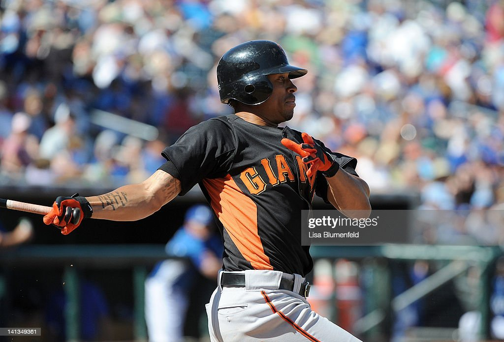 <a gi-track='captionPersonalityLinkClicked' href=/galleries/search?phrase=Emmanuel+Burriss&family=editorial&specificpeople=590006 ng-click='$event.stopPropagation()'>Emmanuel Burriss</a> #2 of the San Francisco Giants at bat against the Kansas City Royals on March 12, 2012 in Surprise, Arizona.